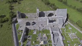 Corcomroe Abbey is an early 13th-century Cistercian monastery located in the north of the Burren region of County Clare, Ireland. stock video footage
