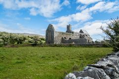 Corcomroe Abbey Ruins. Ruins of Corcomroe Abbey, a Cistercian monastery located in the north of the Burren region of County Clare in Ireland Stock Images