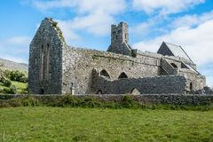 Corcomroe Abbey Ruins. Ruins of Corcomroe Abbey, a Cistercian monastery located in the north of the Burren region of County Clare in Ireland Stock Photo