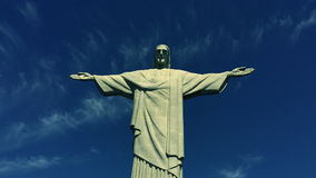 Corcovado Christ the Redeemer Rio de Janeiro Brazil Clouds. Wispy clouds drift past Corcovado Christ the Redeemer statue standing under bright blue sky in Rio de stock video