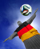 Corcovado with German Flag. Corcovado statue and Brazuca football at Rio, Brasil. With German flag and Copyspace Stock Images