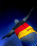 Corcovado with German Flag. Corcovado statue at Rio, Brasil wearing Germany flag. With Copyspace Stock Photo