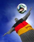 Corcovado med den tyska flaggan Arkivbilder
