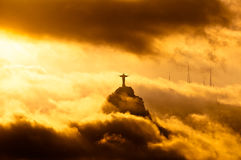 Corcovado Mountain with Christ the Redeemer Statue. In Clouds on Sunset in Rio de Janeiro, Brazil Royalty Free Stock Photos