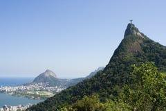 Corcovado Mountain and Forest. Christ the Redeemer, iconic symbol of Rio de Janeiro, on top of Corcovado Mountain. Brazil Stock Photos