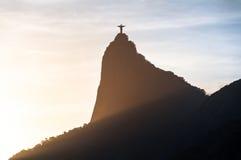 Corcovado Mountain Silhouette. The famous Rio de Janeiro landmark - Christ the Redeemer statue and Corcovado mountain silhouette by sunset Stock Photos