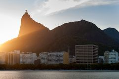 Corcovado Mountain in Rio de Janeiro by Sunset. Corcovado Mountain by Sunset View, with Buildings of Botafogo District Below Royalty Free Stock Images