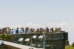 CORCOVADO, RIO DE JANEIRO, BRAZIL - NOVEMBER 2009: crowd of tour. Crowd of tourists looking at the view from lookout point in Corcovado Stock Image