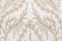 Cordón beige apacible del primer con adornos de las plantas en el backgroun blanco Fotografía de archivo libre de regalías