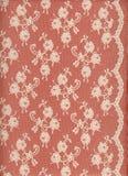 Cordón blanco con la frontera en fondo rojo Imágenes de archivo libres de regalías