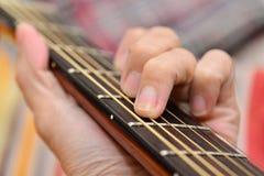 Cordón de la guitarra imagenes de archivo