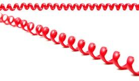 Cordón de teléfono rojo Fotos de archivo