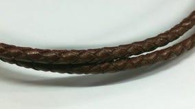 Cordón del cuero de Brown en el fondo blanco Imágenes de archivo libres de regalías