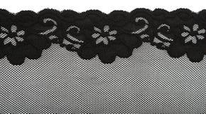 Cordón negro con el modelo con la flor de la forma Foto de archivo libre de regalías