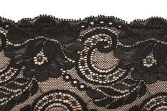 Cordón negro y modelo beige Fotografía de archivo