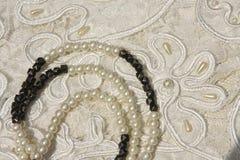 Cordón y perlas Imágenes de archivo libres de regalías