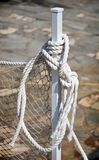 Cord. The white rope tied to a post Royalty Free Stock Images