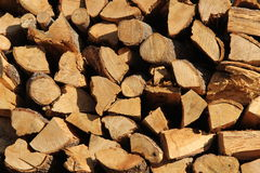 A cord of cut wood. A cord of oak wood cut to burn in a fireplace stock images