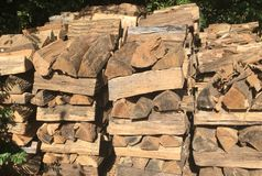 A cord of firewood stacked. A cord of stacked dried oak firewood for winter stock image