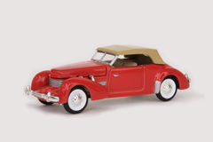 Cord Phaeton 1937. 1937 Cord Phaeton, Racing Champions Mint Edition #1, 1996, 1:64 scale diecast (front left low angle view Royalty Free Stock Images