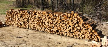 Cord of Seasoned Firewood. This is the site of a local firewood farm in Bartlett, Tennessee, the majority of this wood is destined for local homes and businesses royalty free stock photo