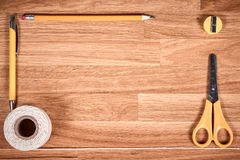 Cord, string, pencil, pen and sharpener on brown wooden table Royalty Free Stock Images
