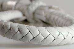 Cord from a white leather royalty free stock image