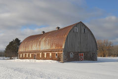 Cord wood barn in winter. Scenic view of traditional cord wood barn in snowy winter countryside, Michigan, U.S.A Royalty Free Stock Image
