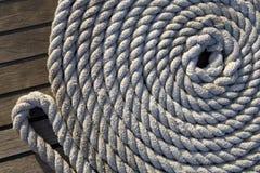 Corda bianca su una superficie di legno Fotografie Stock