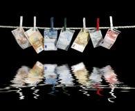 Corda da bucato e soldi Fotografia Stock Libera da Diritti