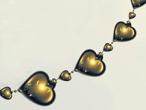 Corda de corações do ouro Fotografia de Stock Royalty Free