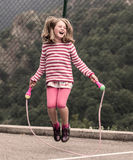 Corda de salto da menina Foto de Stock