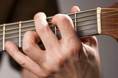 Corda della chitarra acustica Fotografie Stock