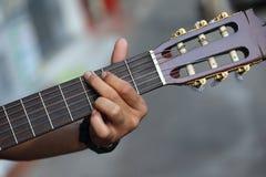 Corda della chitarra giocata Fotografia Stock