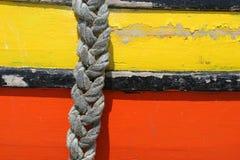 Corda di attaccatura in un vecchio boad Fotografia Stock