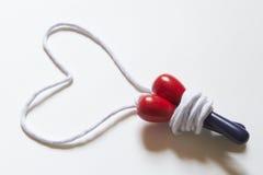 Corda di salto che forma una figura del cuore Fotografie Stock Libere da Diritti