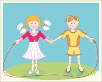 Corda di salto sorridente allegra dei bambini Immagini Stock Libere da Diritti
