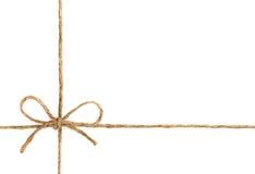 Corda o cordicella legata in un arco isolato su bianco Fotografia Stock