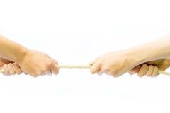 Corda puxando de quatro braços Fotos de Stock Royalty Free