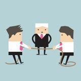 Corda puxando do homem de negócios, conflito, no negócio Foto de Stock Royalty Free