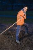 Corda puxando do menino na noite Imagens de Stock