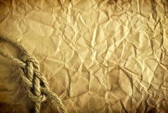 Corda sui vecchi precedenti di carta Fotografia Stock