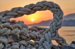 Corda velha, abandonada do ` s do pescador durante o nascer do sol Fotografia de Stock Royalty Free