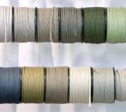 Cordage. Rolls of pastel colors cordage on bright background Stock Photography