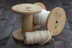 Cordage in spools. Spools of twine on a wooden plank Stock Photos