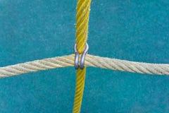Cordas prendidas por uma braçadeira Imagem de Stock Royalty Free