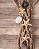 Corde, étoile de mer, pierres de mer Images stock