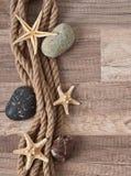 Corde, étoile de mer, pierres de mer Image stock
