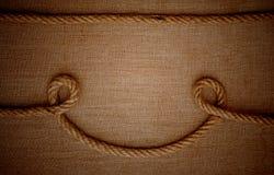 Corde con una tela di canapa di tela da imballaggio Fotografie Stock