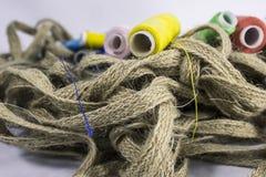 Corde de chanvre et bobines de fil Photo stock